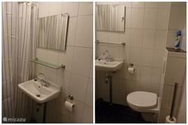 De badkamer is voorzien van een (hangend) toilet, een wastafel met warm -en koud stromend water en een douchegedeelte.