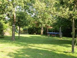 The large enclosed garden with trampoline, swing and possibly a hammock in the summer.