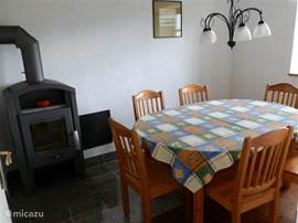 The dining room with wood-burning stove.