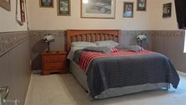 Slaapkamer 3 ingericht met verschillende golf accenten