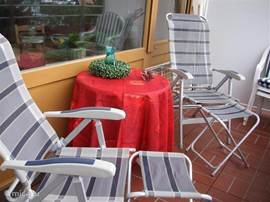 Sun balcony with deck chairs