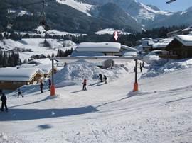 Ski vanuit de tuin het familie ski-oord Dachstein West in