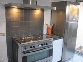 Large American fridge and 5 burner stove with a large oven