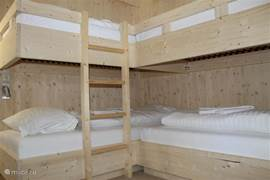 Bedroom with 2 full bunk beds.