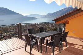 Very spacious terrace with stunning views, privacy, sun canopy and table and chairs.