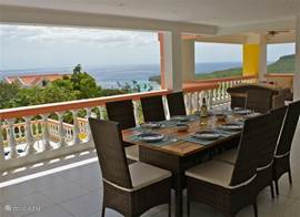 The dining area has a view of the sea