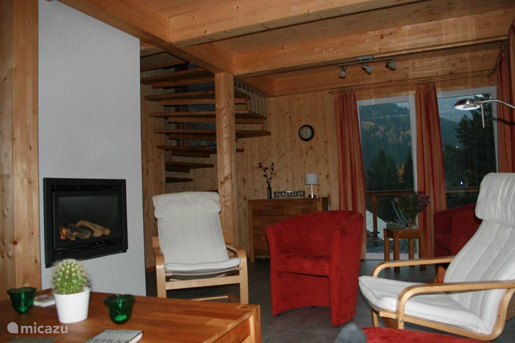 Cozy living room with gas fireplace, heated floors and lovely lounge chairs, for after exercise in nature, after enjoying an exciting day Austria.