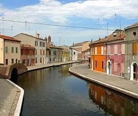 In Comacchio kunt u genieten van de authentieke sfeer van Emilia Romagna.