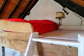 Double bed in the attic of a separate annex