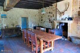 The dining table and behind a large wood burning stove