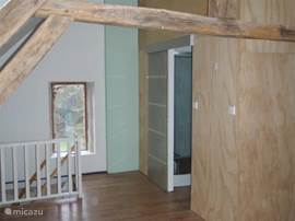 Also upstairs view of the beams. This contrasts: modern bathroom with rain shower.