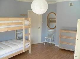 De slaapkamer op de 1e verdieping.