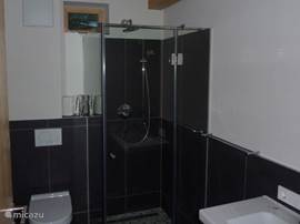 2 additional bathrooms with shower, toilet, sink and floor heating
