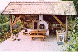The luxurious outdoor kitchen with pizza oven, stove with oven and grill. built-in kitchen with hot and cold water etc.
