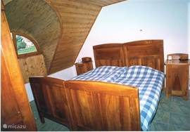 rear bedroom with 2 bed and a large linen closet overlooking the garden, mountains and Lake Balaton