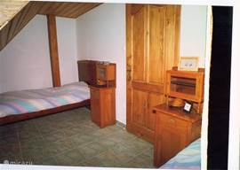 middle bedroom with two single beds one overlooking the garden, mountains and Lake Balaton