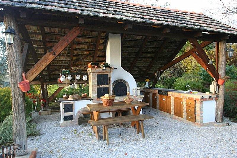 The luxury outdoor kitchen with pizza oven, stove with oven and grill. built-in kitchen with hot and cold water etc.