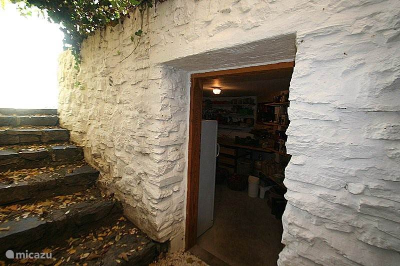 Storage located next to the entrance to the wine cellar