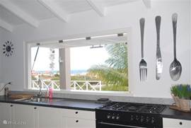 Open kitchen with terrace and sea view