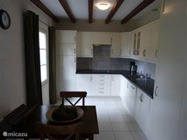 Complete kitchen with refrigerator and freezer drawers, dishwasher, stove, microwave, coffee maker and Senseo. Washing machine in separate room.