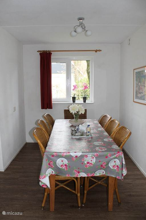 The dining area with nine seats including two comfortable armchairs also geschilkt as extra chairs in the seating area.