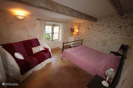 One of the bedrooms on the first floor with a double bed
