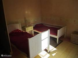 The bedroom on the ground floor with two single beds