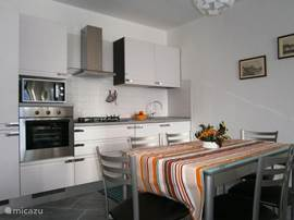Modern luxury kitchen with oven, fridge, freezer, microwave, dishwasher and coffee maker