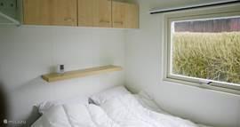 Slaapkamer 1 beschikt over een tweepersoonsbed