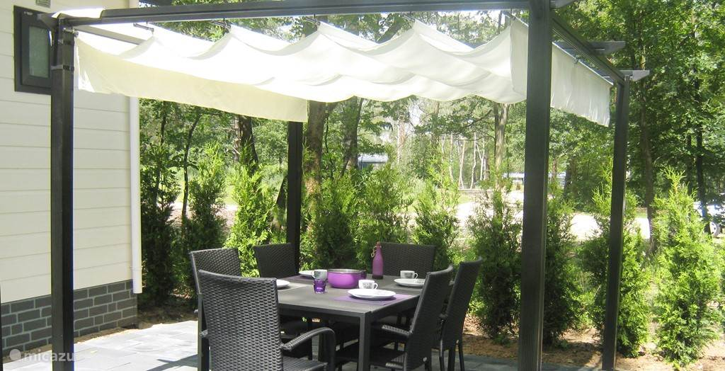 Neem plaats op het terras en geniet van het buitenleven