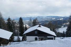 A view of the home and the mountains by winter.