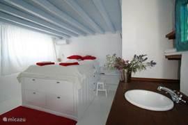 bedroom upstairs, with big panoramic views