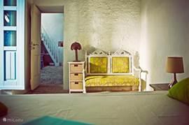 downstairs bedroom, door opening to the living room