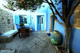 the courtyard with the mandarin tree for shade in the summer. beautiful hand laid pebbled floors laid stone by stone in the typical mosaic.