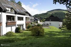 The complex from the garden, through the garden a babbling mountain stream which is a fantastic playground for children