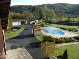 view from the balcony, overlooking the garden, pool, garage and driveway