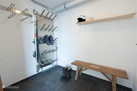 Large ski room for up to 12 pairs of skis with shoe heater for 10 pairs of shoes.