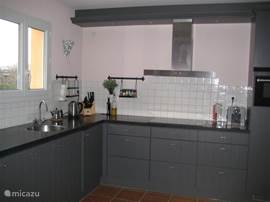 The spacious and modern kitchen with dishwasher, extra large fridge, separate freezer and oven with microwave.