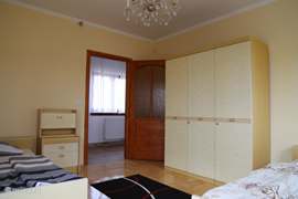 The linen closet in the bedroom with two single beds. (House 'Kronos')