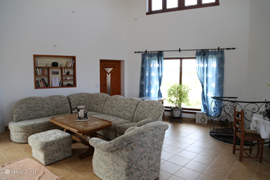 This is the hall that can serve as a common room where you are staying with a group here. Each house also has its own living area. Right shows the spiral staircase leading to the basement. In the basement is the central heating system (wood) and hot water (using solar energy)