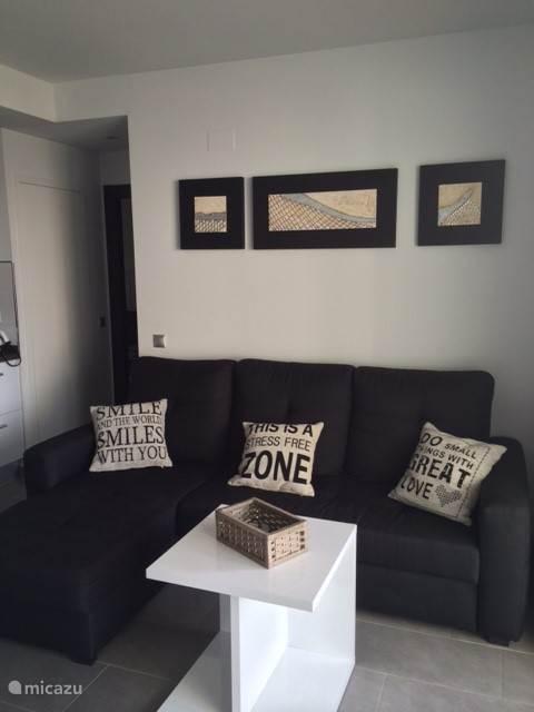 Woonkamer met comfortabele zetel