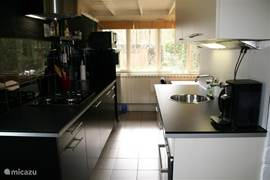 Kitchen, fully equipped, including dishwasher, microwave oven, electric kettle, coffee device setup.