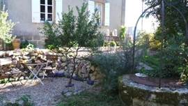 Secluded garden with several terraces and well