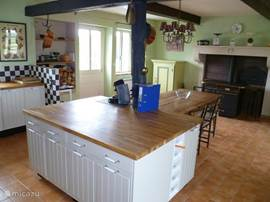 The cozy kitchen with stove and wood stove / cooker.