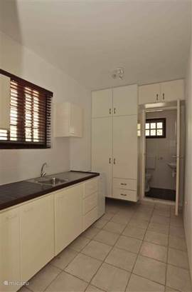 Studio 3 offers a spacious kitchen and bathroom with hot shower, sink and toilet.