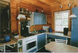 The kitchen is spacious. light and fully equipped