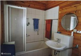 on the ground floor, a nice bathroom with shower, bath and toilet. On the first floor there is a second toilet with washbasin.