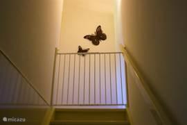 Traphekje boven aan de trap