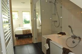 The luxury bathroom with bath and separate shower