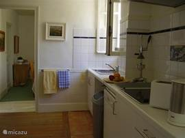 The comfortable kitchen is 13 square meters on the ground floor is a fitted summer kitchen 22 m² in size. There are also a dining table and 6 chairs a fridge, cooker, washing machine, an iron and ironing board.